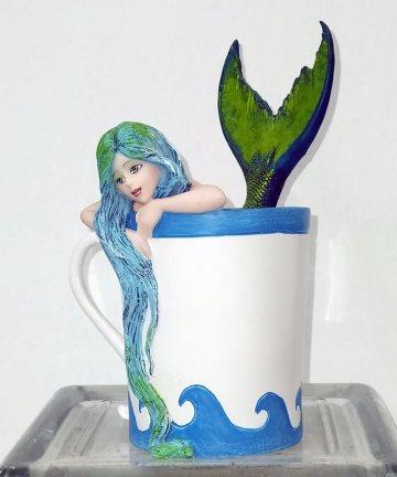 Fata in tazza